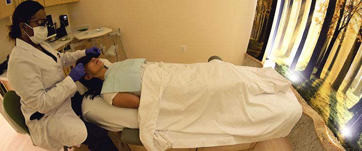 Dr. Bikoi examining a patient